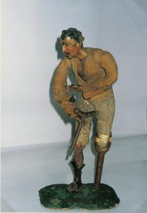 Figurines from the Würtz collection: a wood and cloth figure of a man disabled by scrofulosis