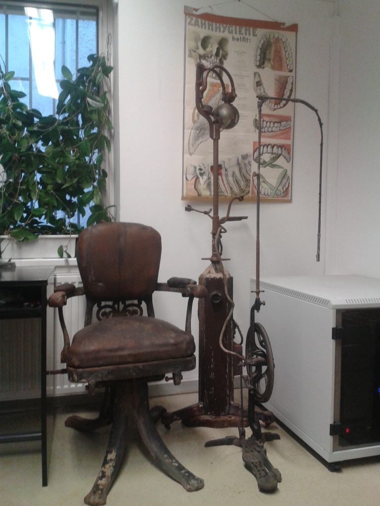 Dental chair and treadle dental drills, early 20th century